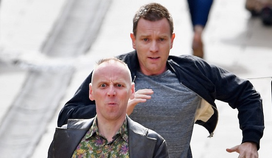 EDINBURGH, SCOTLAND - JULY 13:  Actors Ewan McGregor and Ewan Bremner run on the set of the Trainspotting film sequel on Princess Street on July 13, 2016 in Edinburgh, Scotland. The long awaited Trainspotting 2 is being filmed in Edinburgh and Glasgow, 20 years after the original was released and it will also see the cast from the first film returning including Ewan McGregor, Jonny Lee Miller and Robert Carlyle.  (Photo by Jeff J Mitchell/Getty Images)